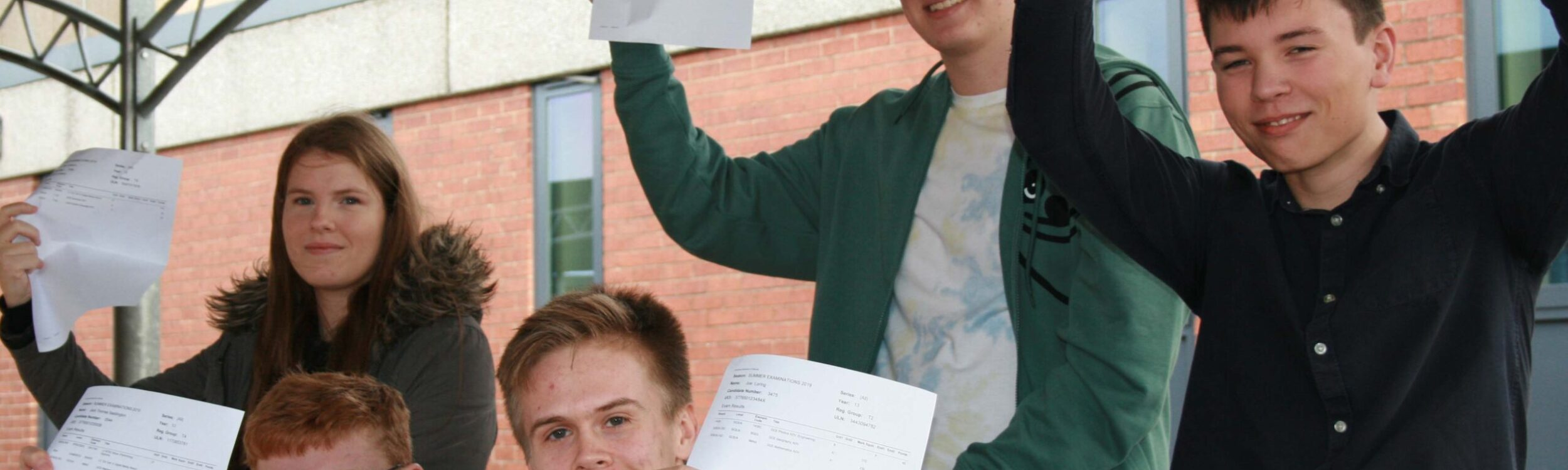 A group of Sixth Form students showing off their A-Level results
